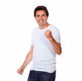 Cheerful guy celebrating victory while standing Stock Photography