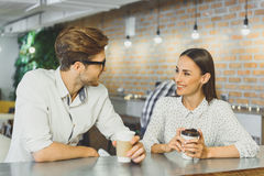 Cheerful guy and girl resting in cafeteria Royalty Free Stock Photography