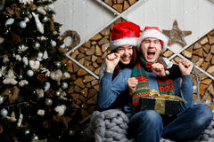 Cheerful guy got Christmas present Royalty Free Stock Photo