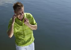 Cheerful guy in a green vest. Stock Image
