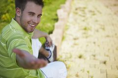 Cheerful guy in a green vest. Royalty Free Stock Images