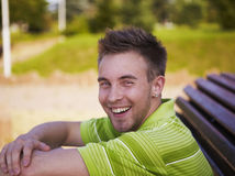 Cheerful guy in a green vest. Royalty Free Stock Photography