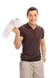 Cheerful guy holding a roll of toilet paper Stock Images