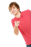 Cheerful guy Peeps and points to you Stock Photos
