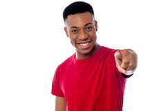 Cheerful guy pointing towards camera Stock Images