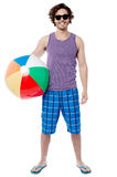 Cheerful guy ready to play beach ball Royalty Free Stock Images