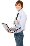 Cheerful guy running on a laptop, dressed in a shirt and tie Stock Images