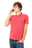 Cheerful guy is standing and talking on a mobile phone Royalty Free Stock Image