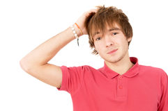 Cheerful guy stands there and thinks, holding my head Royalty Free Stock Images