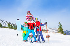 Cheerful guys standing with snowboards and skis Royalty Free Stock Photo