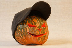 The cheerful halloween pumpkin. On canvas background Stock Photography