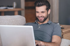 Cheerful and handsome blogger. Royalty Free Stock Images