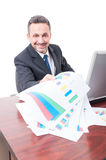 Cheerful handsome businessman with investment charts Stock Photos