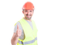 Cheerful handsome engineer with helmet doing thumb up gesture Stock Photos