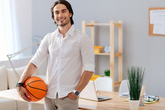 Cheerful handsome man holding basket ball Stock Photo