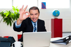 Cheerful handsome manager gesturing perfect sign royalty free stock image