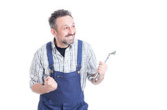 Cheerful handsome mechanic smiling and  celebrating success Royalty Free Stock Photo
