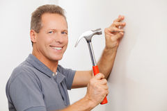 Cheerful handyman. Royalty Free Stock Photo