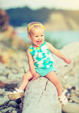 Cheerful happy baby girl laughing on  walk in nature. Cheerful happy baby girl laughing on a walk in nature outdoors in summer Stock Images