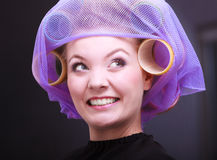 Cheerful happy blond girl hair curlers rollers hairdresser beauty salon Stock Image