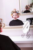 Cheerful happy blond girl hair curlers rollers hairdresser beauty salon Royalty Free Stock Photos