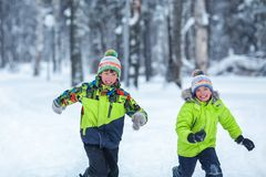 Free Cheerful Happy Boys Playing In Winter Park, Stock Photos - 83793353