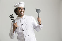 Cheerful happy chef holding kitchen utensil Royalty Free Stock Photography