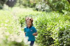 Cheerful happy child running in park Royalty Free Stock Photo