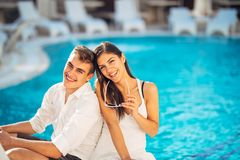 Cheerful happy couple enjoying spa vacation in luxurious summer resort.Honeymoon trip.Anniversary  celebration. Boyfriend and girlfriend having fun.Emotional Royalty Free Stock Photography