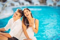 Cheerful happy couple enjoying spa vacation in luxurious summer resort.Honeymoon trip.Anniversary  celebration. Boyfriend and girlfriend having fun.Emotional Royalty Free Stock Photos