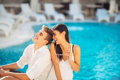 Cheerful happy couple enjoying spa vacation in luxurious summer resort.Honeymoon trip.Anniversary  celebration. Boyfriend and girlfriend having fun.Emotional Royalty Free Stock Image
