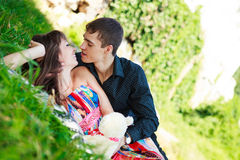 Cheerful happy couple flirt in a sunny summer park Royalty Free Stock Image