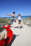 Cheerful happy couple jumping heading to the beach Royalty Free Stock Image
