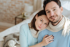 Cheerful happy couple sitting at home Royalty Free Stock Photo
