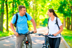 Cheerful and happy cyclists Stock Image