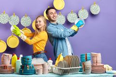 Cheerful happy family enjoying working in the kitchen royalty free stock photos