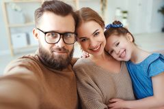 Cheerful happy family mother father and child take selfies, take pictures stock image