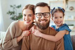 Cheerful happy family mother father and child take selfies, take pictures royalty free stock photo