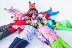 Cheerful happy friends lying in a circle Royalty Free Stock Photography