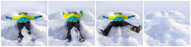 Top view of cute smiling girl lying on snow shows angel. stock photos