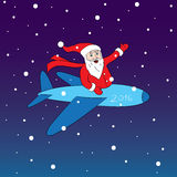 Cheerful and happy Santa. Claus flying in red Christmas costume red color is flying on an airplane and smiling pointing isolate  illustration Stock Photos