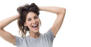 Cheerful woman with messy hair. Cheerful happy woman holding her messy long hair, she is having a bad hair day stock photography