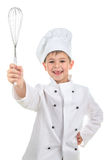 Cheerful happy young chef assistant demonstrates cooking whisk, isolated on white background. Food and cooking concept. royalty free stock image