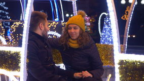Cheerful happy young couple having fun at Christmas fair stock video footage