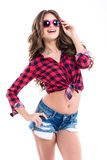 Cheerful happy young woman in casual clothes and pink sunglasses Stock Photography