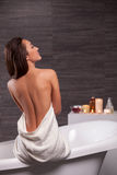 Cheerful healthy girl is having her tub Royalty Free Stock Photo