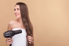 Cheerful healthy girl is using modern hairdryer Royalty Free Stock Photo
