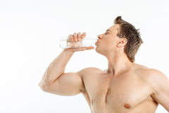 Cheerful healthy young man is very thirsty Royalty Free Stock Photo