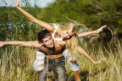 Cheerful heterosexual young pair on the nature Stock Images