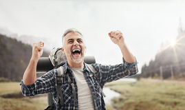 Cheerful hiker celebrating with raised fists Royalty Free Stock Photography